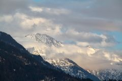 Snowy mountain in clouds Royalty Free Stock Photos