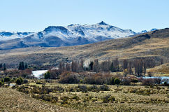Snowy mountain in the distance Royalty Free Stock Image