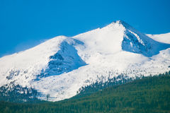 Snowy mountain. High mountain peaks covered with snow Stock Photos