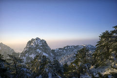 Snowy mountain huangshan sunrise. Distant view Royalty Free Stock Photography