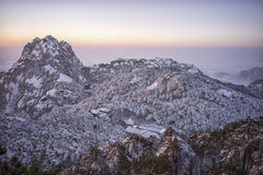 Snowy mountain huangshan sunrise. Distant view Royalty Free Stock Images