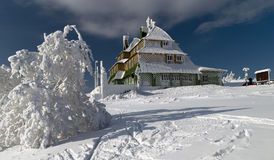 Snowy mountain hut royalty free stock images