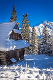 Snowy mountain hut in the mountains Stock Photo