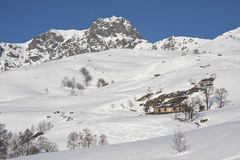 With snowy mountain huts in the Alps. Italy Elvo Valley Mount Mucrone snow Stock Images
