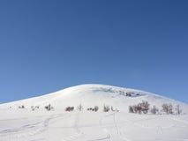 Snowy mountain. Mountain i Härjedalen, Sweden a sunny winter day Stock Photos