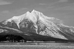 Snowy Mountain and Lake Ice in Black and White Royalty Free Stock Image