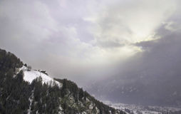Snowy mountain landscape. A typical image for the winter times in the Alps - with the changing weather from snowy to sunny Royalty Free Stock Images