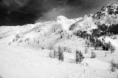Snowy mountain landscape b&w with red filter Royalty Free Stock Photo