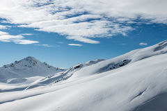 Snowy mountain landscape on the blue sky background Stock Images