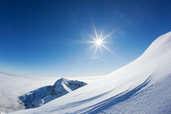 Snowy mountain landscape in a winter clear day. Stock Photo