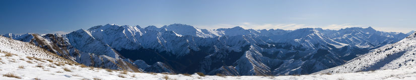 Snowy Mountain Panorama. Snow covered mountain range from Ben Lomand saddle, NZ stock photo