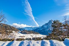 Mountain panorama with village. Snowy mountain panorama with village in Italy Royalty Free Stock Images