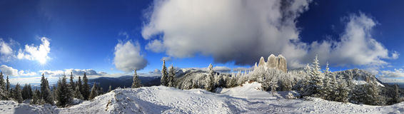 Snowy Mountain Panoramic.Lonely Rock Royalty Free Stock Photography