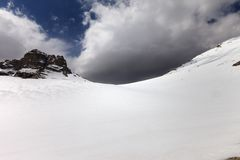Snowy mountain pass and sky with storm clouds Stock Photography
