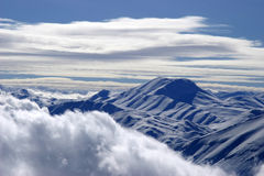 Snowy mountain peak. Bright white Clouds and snow mounains (Turkey Stock Images