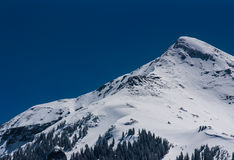 Snowy mountain peak Stock Image