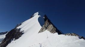 Snowy mountain peak Stock Images