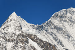 Snowy mountain peak - beauty of nature. Snowy mountain peak high in Himalayas - beauty of nature Royalty Free Stock Images