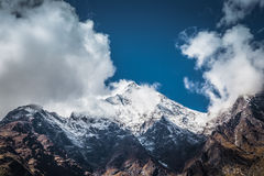 Snowy mountain peak and clouds, Himalaya, Nepal. View from the  Annapurnas circuit, Himalaya, Nepal Royalty Free Stock Images