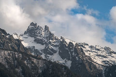 Snowy mountain peak in the evening or in the morning Royalty Free Stock Photos