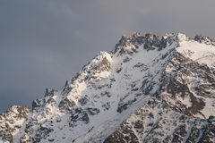 Snowy mountain peak in the evening or in the morning Royalty Free Stock Photography