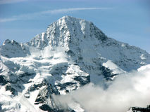 Snowy Mountain Peak. A picturesque view of a snowy mountain peak in the Swiss Alps Stock Images