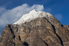 Snowy mountain peak view from the foot in. Stock Photography