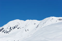 Snowy mountain peaks Stock Images