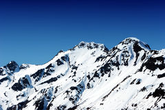 Snowy mountain peaks Stock Photo