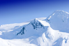 Snowy mountain peaks Stock Photography