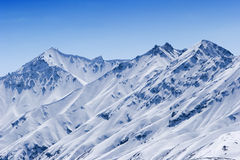Snowy mountain peaks Royalty Free Stock Photography