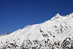 Snowy mountain peaks and blue clear sky Stock Photo