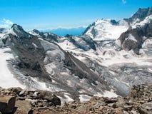 Snowy mountain peaks. Caucasus, Elbrus region. View of the snow-covered mountain peaks. Caucasus, Elbrus region royalty free stock images