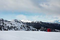Snowy mountain peaks in the Dolomites.. Empty ski slope in winter on a sunny day. Prepare ski slope, Alpe Cermis, Italy Stock Photos