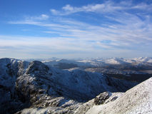 Snowy mountain peaks Scotland. Scenic view of snowy mountain peaks in Scotland Royalty Free Stock Image