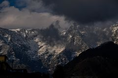 Snowy Mountain Peaks Under Cloudy Sky royalty free stock photography