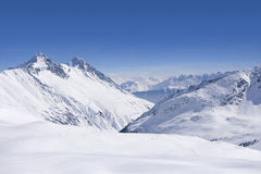 Snowy mountain range and blue sky Royalty Free Stock Images