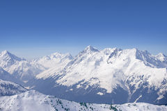 Snowy mountain range and blue sky Stock Images