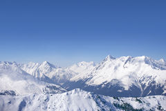 Snowy mountain range and blue sky Stock Photo