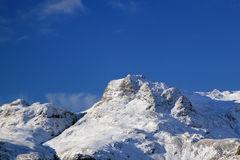 Snowy mountain range Stock Images