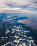 Snowy mountain range from plane royalty free stock images