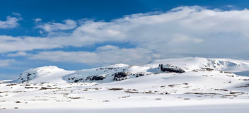 Snowy mountain range Stock Images