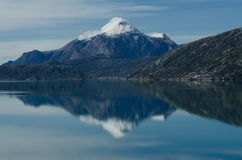 snowy mountain reflection in Greenland fjord Stock Photos
