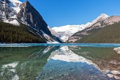 Snowy mountain reflection on lake Louise - Banff , Alberta, Canada Stock Image