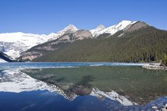 Snowy mountain reflection on lake Louise - Banff , Alberta, Canada Stock Photos