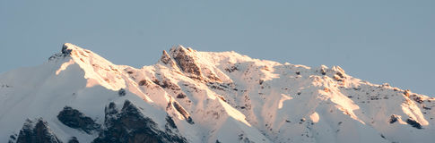 Snowy mountain ridge in the Alps at first light Stock Photo