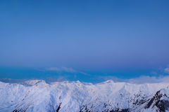 Snowy mountain ridge winter morning Stock Photo