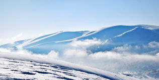 Snowy mountain ridges Stock Image