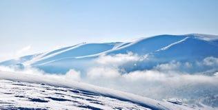 Snowy mountain ridges Stock Image