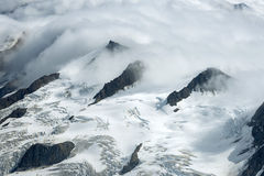 Snowy Mountain Ridges in the Clouds, Kluane National Park, Yukon Royalty Free Stock Image